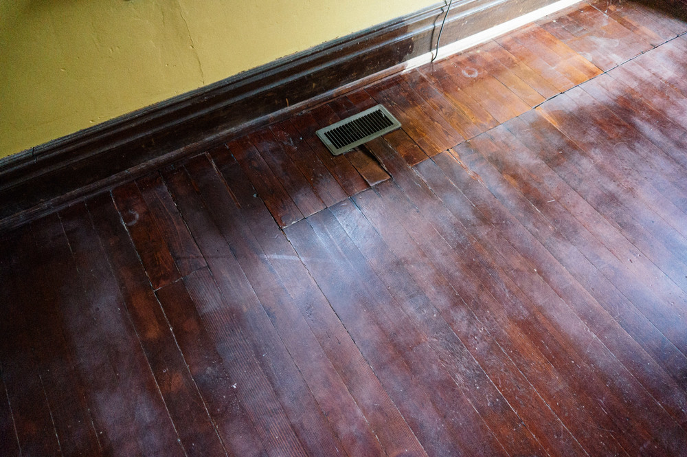 The floors in the living room were in the worst shape, by far.
