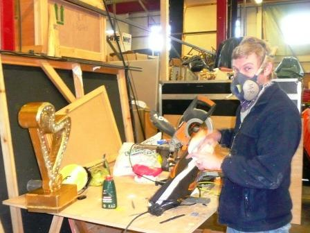 Mike is painting up the golden harp for Jack and the Beanstalk, Crewe, and making a new plinth for it.