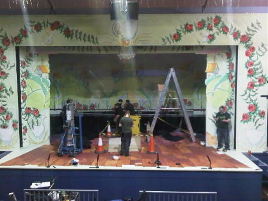 ... meanwhile, on stage, the set fit-up has started.