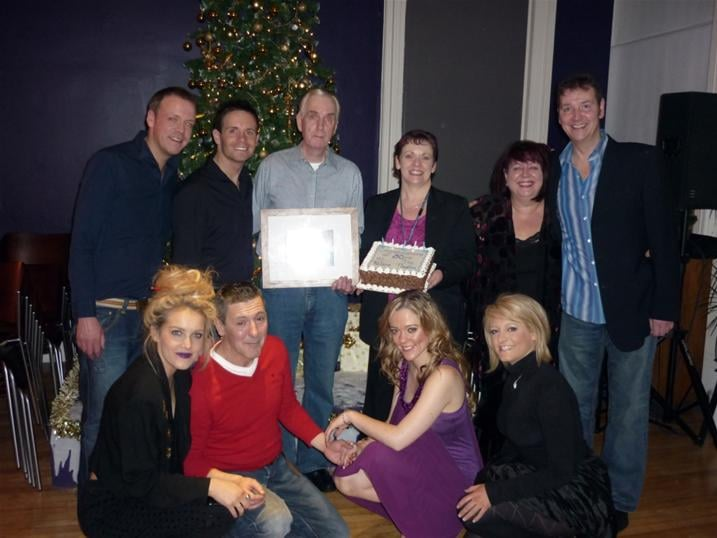 The panto cast with Ian, one of the back stage crew, who was surprised with a cake and gift to celebrate his 50 years at the Palace. L-R back - Andrew Findlater (plays Smiley and Fusspot), Liam Dolan (Director and Josh the Jester), Ian (Backstage, celebrating 50 years at the Palace), Janice Gilmour (Theatre Manager), Brenda Cochrane (Bad Fairy Carabosse) and John Hannibal (Dame Nanny Nora Noo) L-R Front - Laura McMonagle (Prince Valiant), Stevie Hannan (King Bumble), Adele Rankin (Princess Belle) and Louise McCarthy (Good Fairy Azuriel)