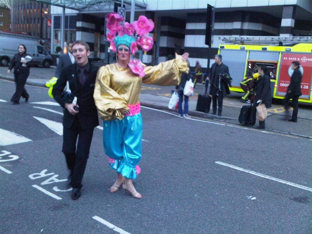Theatre Manager J-J Almond escorts Panto Dame Graham Kent out of the building while the London Fire Service enter the building behind!