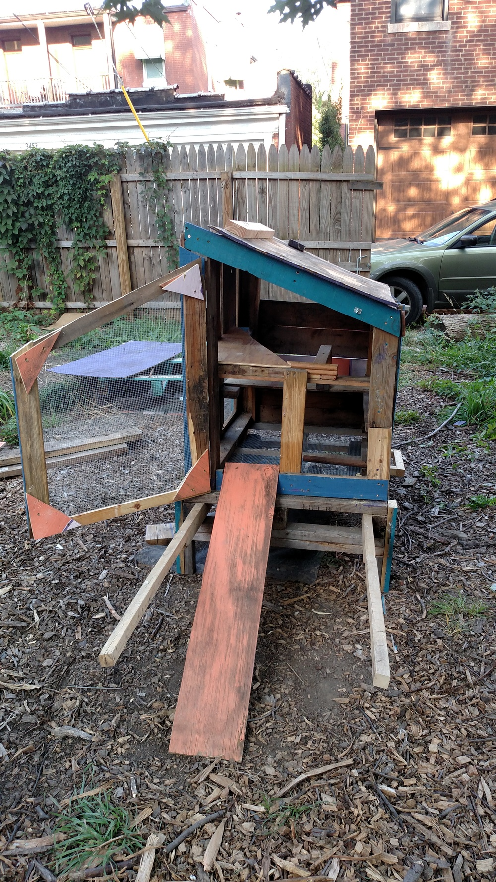 We repurposed a falling-apart chicken coop and built an all new home for the birds from the remnants of the old one, with an easy to move wheel system that allows the client freedom of the yard for the chickens.