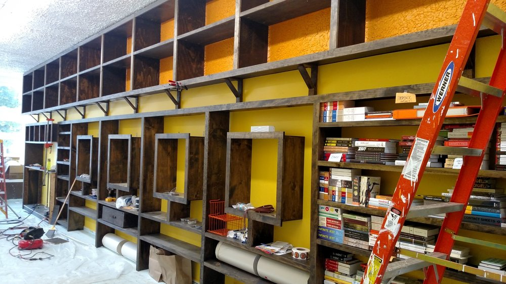 Shop build out for South City Art Supply's first shop on Cherokee St. We created custom shelving for their retail displays and a rolling ladder for easy access.
