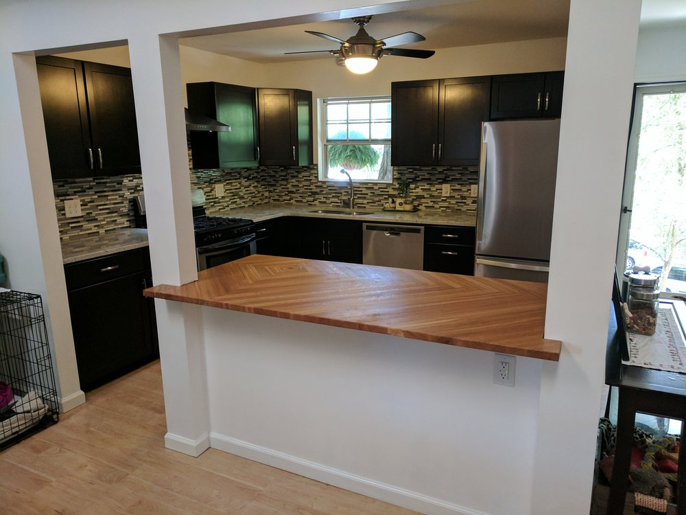 kitchen remodel including appliance and cabinet install, tile backsplash, and a custom butcher block kitchen island countertop in this Webster Groves home