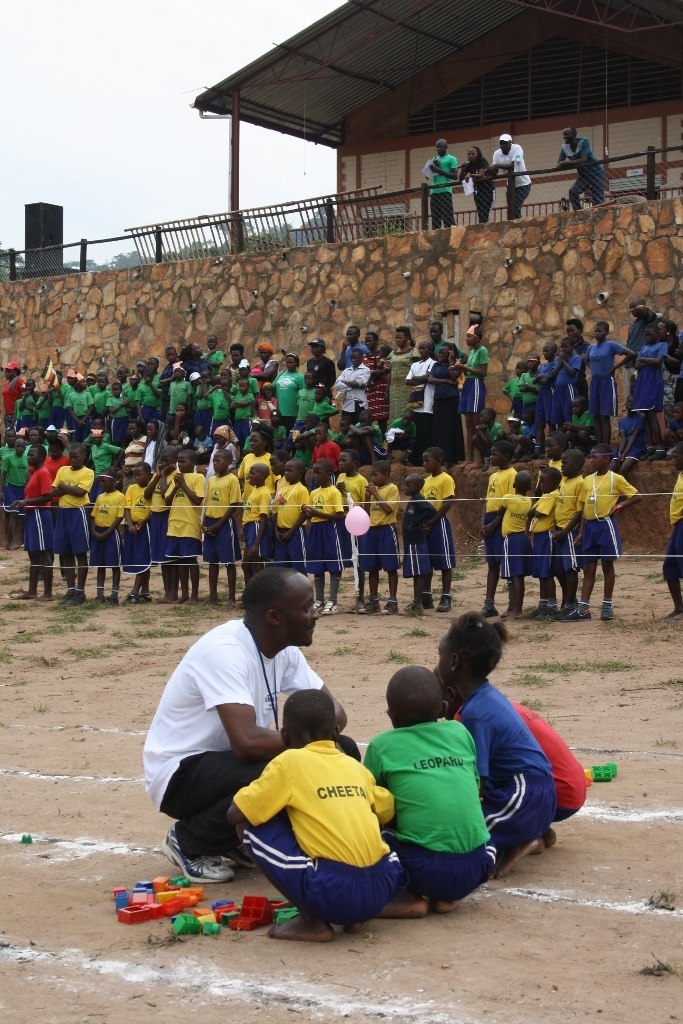 Teacher Joseph helped encourage the students before each activity as the crowd watched on.