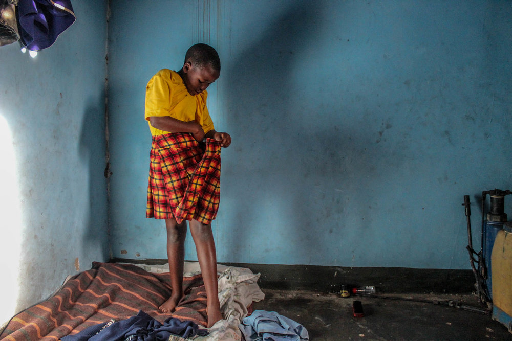 Goretti changes out of her school uniform once she returns home. This is the room Goretti and her cousins sleep in.