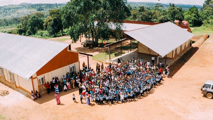 Completing the build of our 16 classroom secondary school which includes a kitchen, staff room, 2 science labs, health clinic and outdoor amphitheatre.