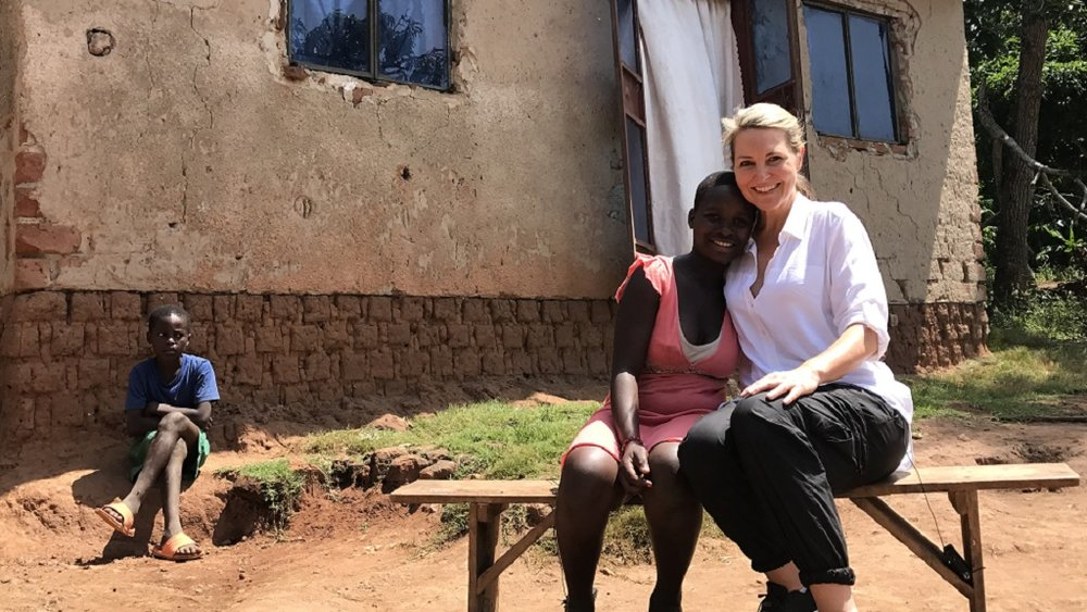 One of our students Esther shows Georgie her home in the local village.