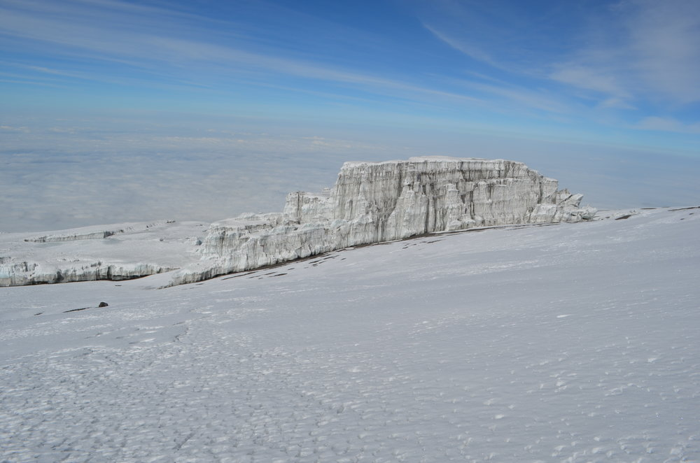 See the spectacular glaciers along the summit <br> crater rim.