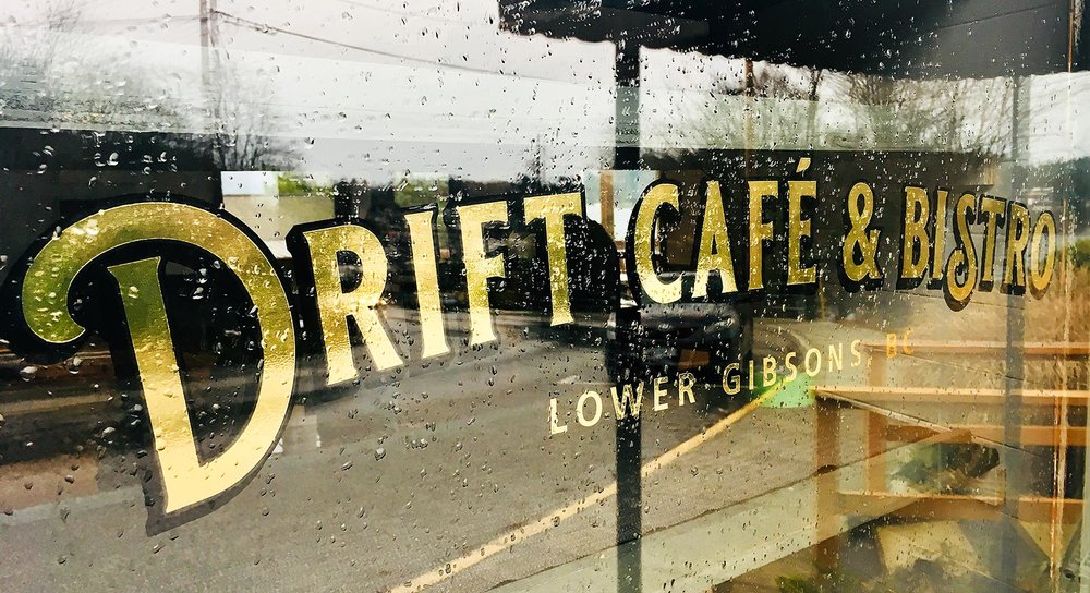 Metallic gold and black window graphics for Drift Café & Bistro in Gibsons.