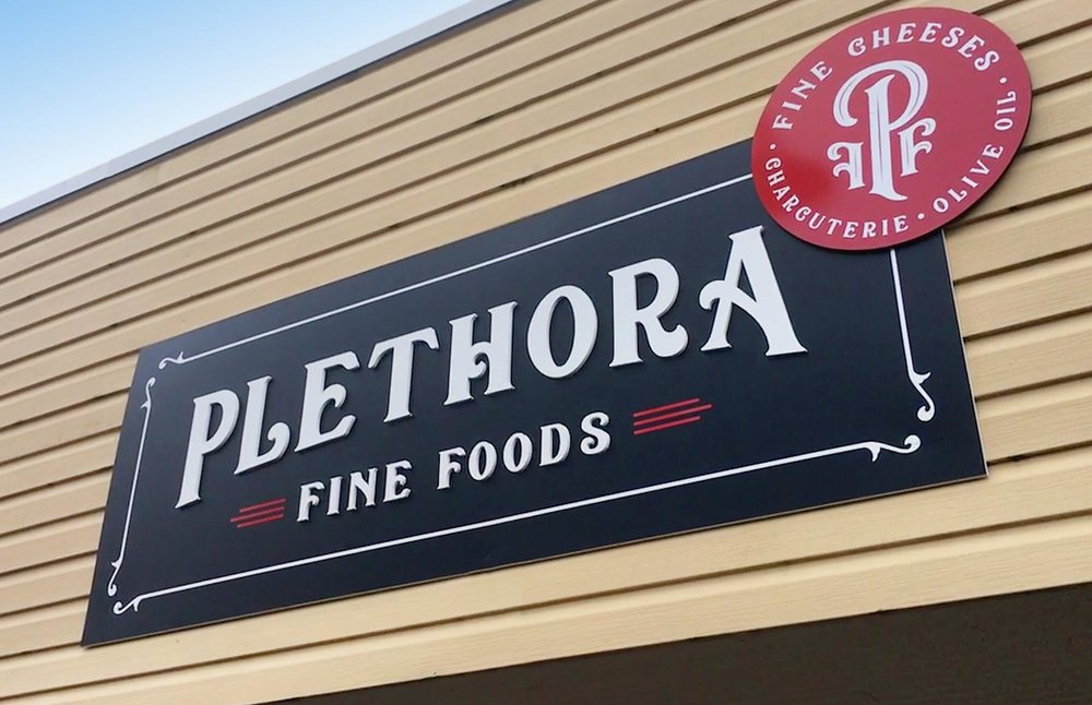 Dimensional wall sign for Plethora Fine Foods in Sechelt.