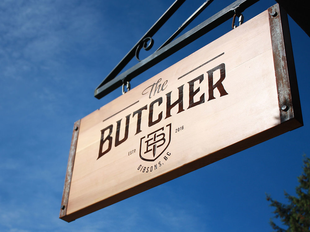Last etched wood sign for The Butcher