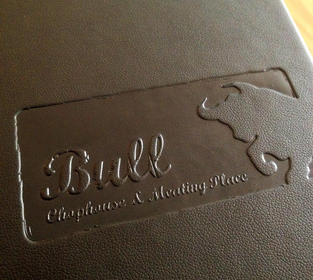 Blind debossed menu covers for Bull.