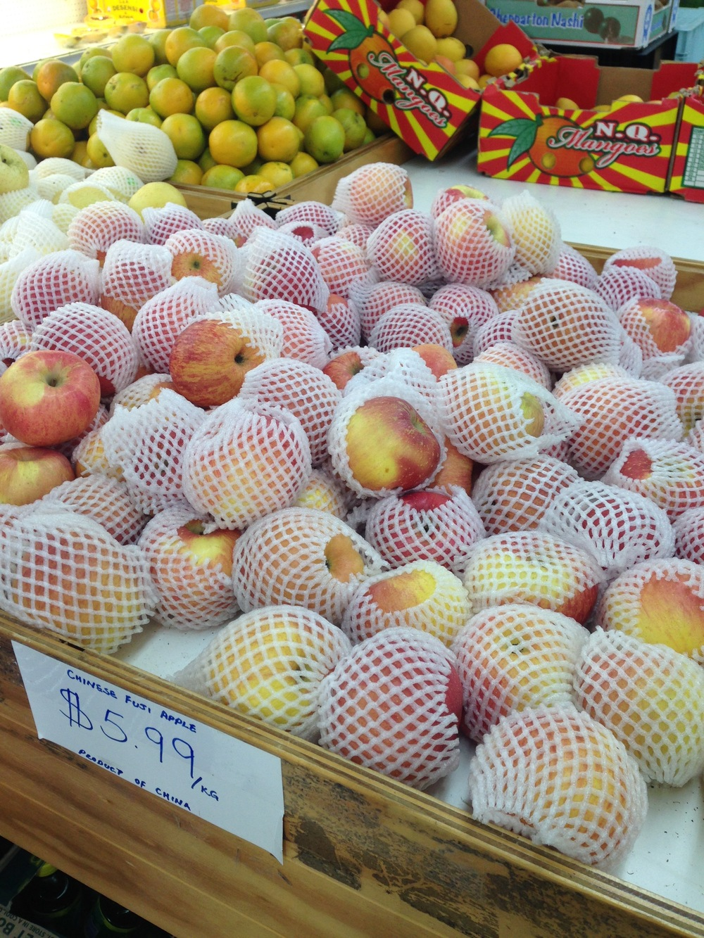 Fuji apples in Chinatown, each needing their own polystyrene protector.