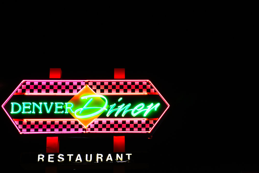 The neon lights of the Denver Diner shine on August 1, 2018.