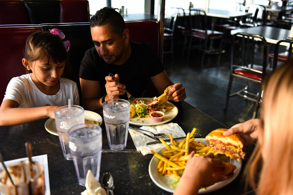 7 p.m.: Members of the Marquez family (Alyssa, left, Chris and Cynthia) order their food, with Alyssa splitting her parents' entrees. They live in Albuquerque but come to the diner when they're in Denver. They'll drive back to New Mexico after their meal.