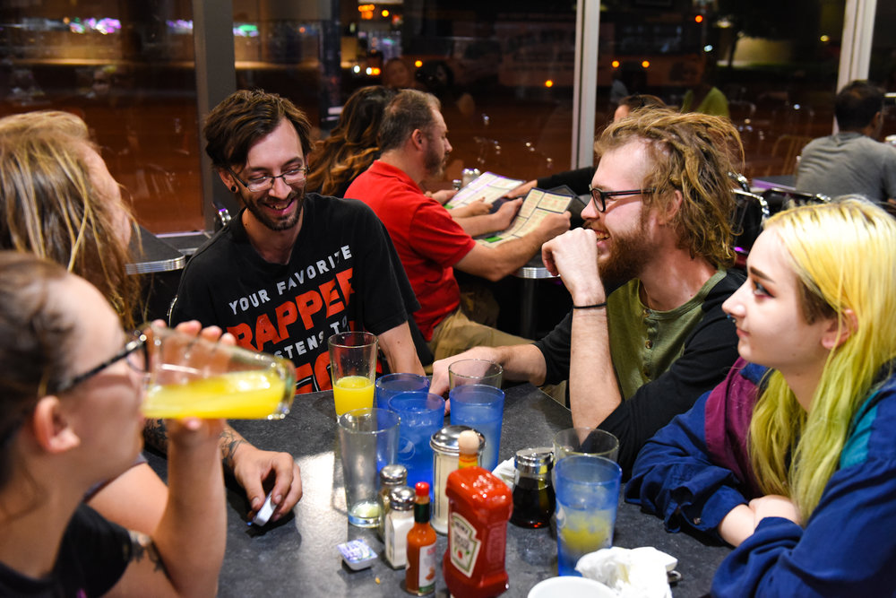 10 p.m.: Friends gather around a table. All are originally from Minnesota, but four currently live in Colorado.