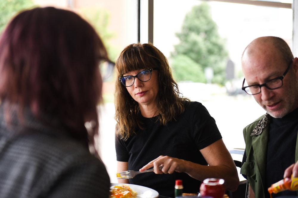 10 a.m.: Taya Hoy (left), Judy Wesman and Eric Hoy eat breakfast.