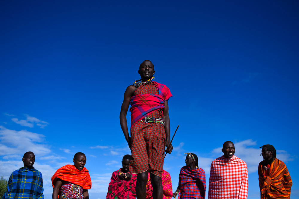 Aa group of men practice the jumping ceremony dance, in which the man who jumps the highest is most desirable.