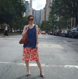 Hillary wears a Ready to fish by Ilja top, a Shana Luther handbag coupled with TOPSHOP culottes and Chloe sandals.
