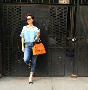 Hillary wears MIH Jeans coupled with Miu Miu sunglasses, a DVF handbag and Chloe heels.