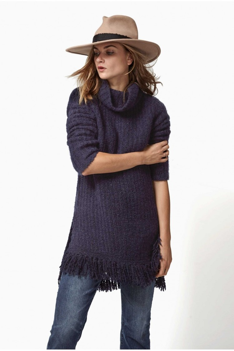 The Ajax sweater is our most lux piece of the season – Cashmere and silk boucle Italian yarn knitted into an asymmetrical turtleneck a fringe hem. It is the softest thing I've ever worn!