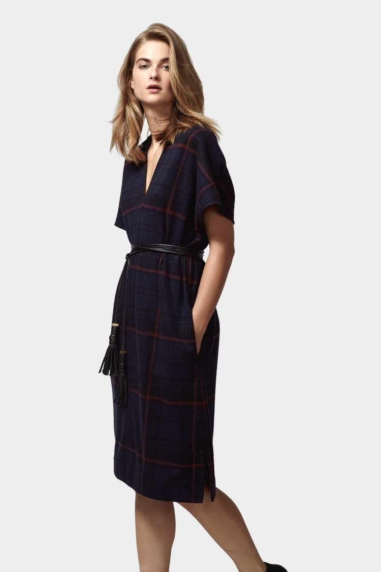 The Highlands Flannel Dress is beyond cozy and soft. Perfect for laying over a black turtleneck and thick tights.