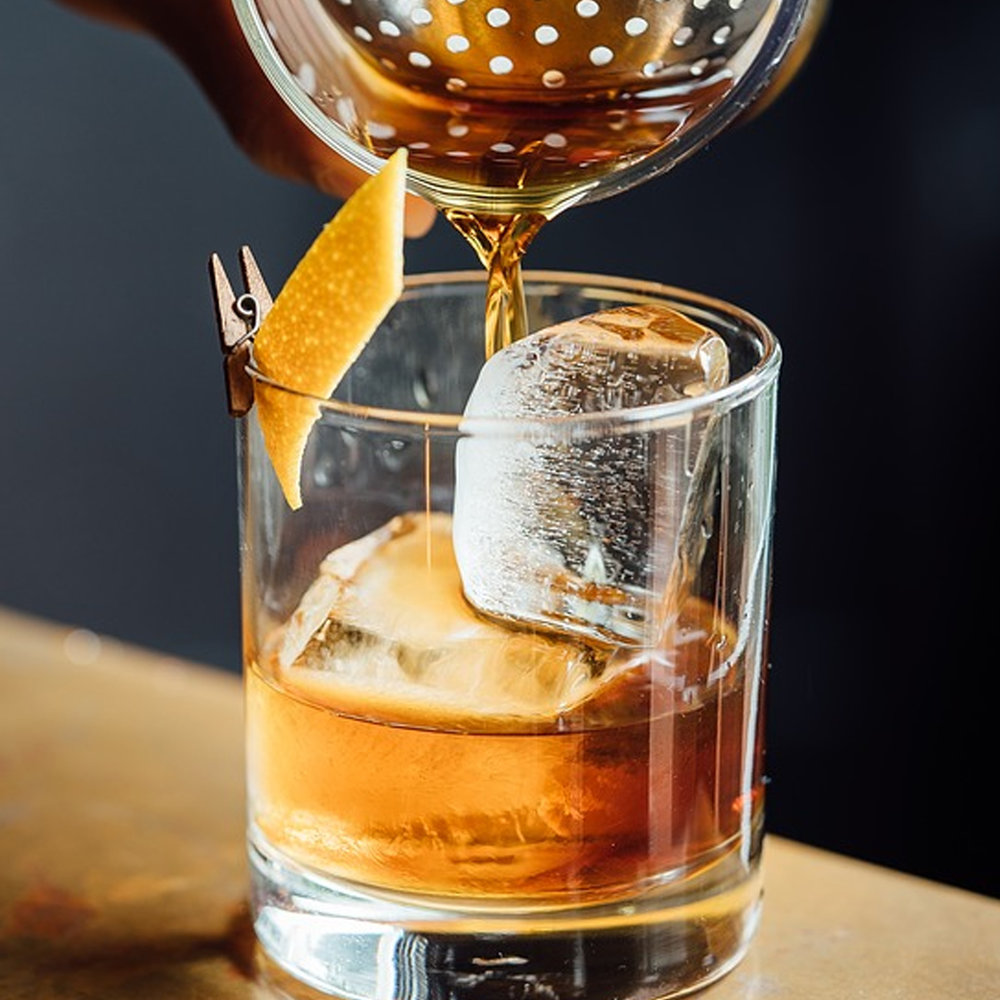 Old Fashioned: A muddling of bourbon, orange with a dash of cherry