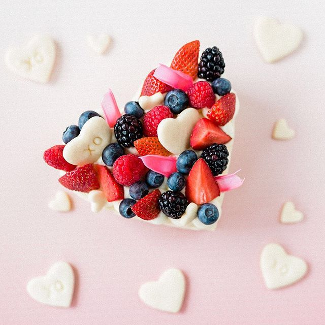 "Love is in the air as we approach February! 💕 You still have time to order one of these 6"" layered cookie cakes for Valentine's Day for $20! They are soft sugar cookies layered with poofs of cream cheese frosting and topped with fresh berries, chocolate shards & a few more mini cookies.. the perfect in between of healthy & indulgent! 🤤 Pickups would be the evening of Feb 13th in Lancaster. Email itsgonnabesweetbakeshop@gmail.com to order! 📷: @jasonandlaurie"