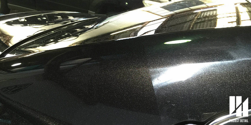 50/50 shot of the same Lexus undergoing paint correction. Left side shows corrected paint.