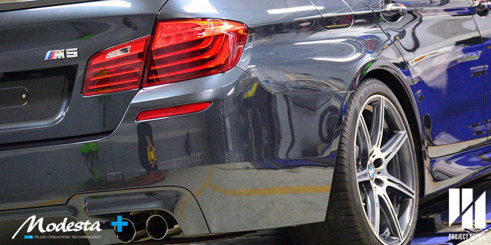 The BMW M5 had water spots removed and is now protected exclusively with Modesta.