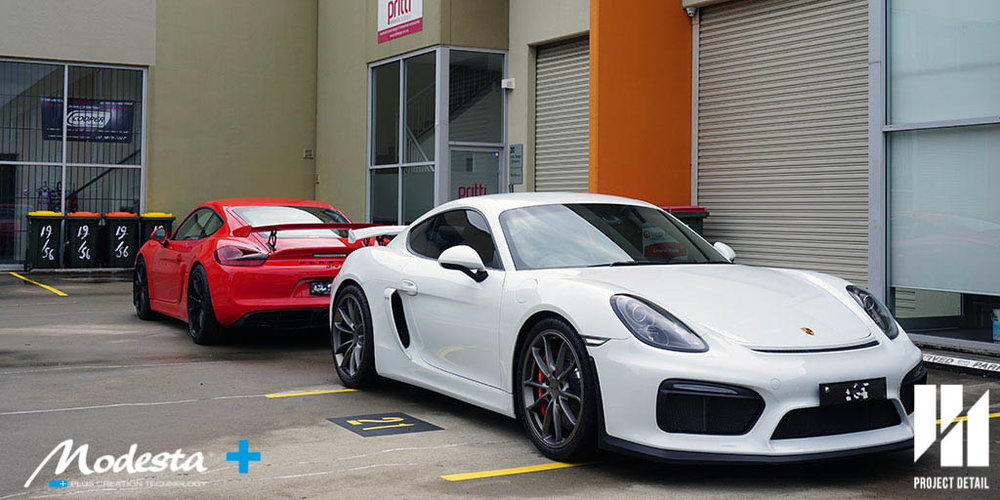 Two Porsche Cayman GT4's in Guards Red and Carerra White Metallic, both wrapped in PPF, coated and protected in Modesta Glass Coating by Project Detail in Gladesville, Sydney.
