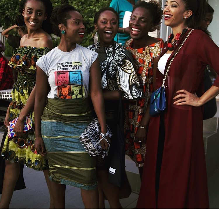left to right  Afrodesiac Worldwide ,  Lokko 8 ,  Bot i Lam ,  Tina Lobondi ,  Dionne Gooding  . Purses  Velma Millinery ,  Myth House Bag,   Anansi Bag , Accessories:  Emma Bird