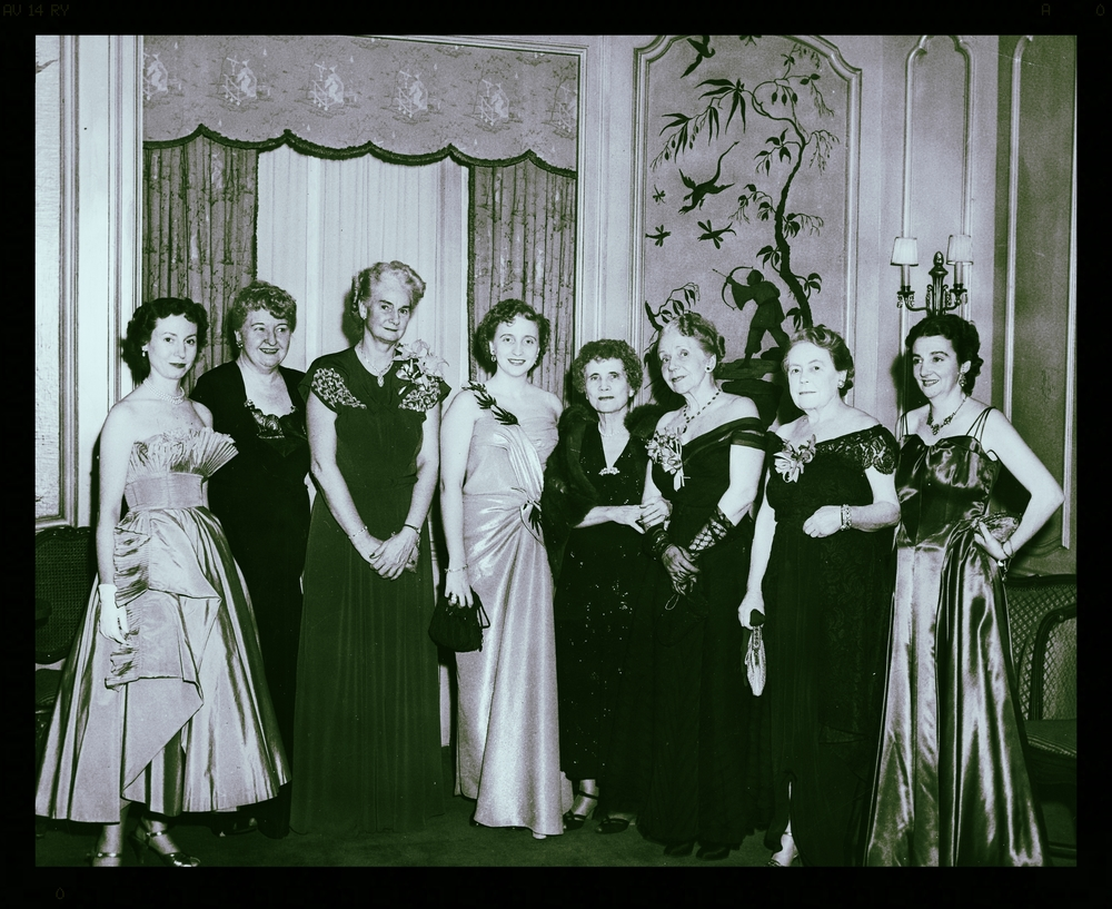 A host of legendary reporters formed the reception committee of the New York Newspaper Women's Front Page Ball, attended by Margaret Truman (far left). They included Dorothy O'Neill; Ethel Mockler; Marian Clyde McCarroll; Helen Rogers Reid, president of the New York Herald Tribune; Virginia Pope, and Anne O'Hare McCormick.