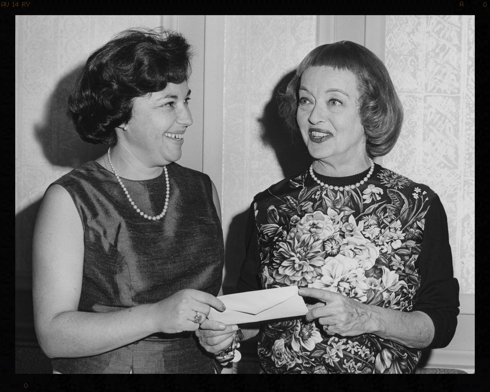 Rosalind Massow, Woman's editor of Parade, and actress Bette Davis at a Front Page Ball. Massow was president of the Newswomen's Club of New York in 1964 and 1965.