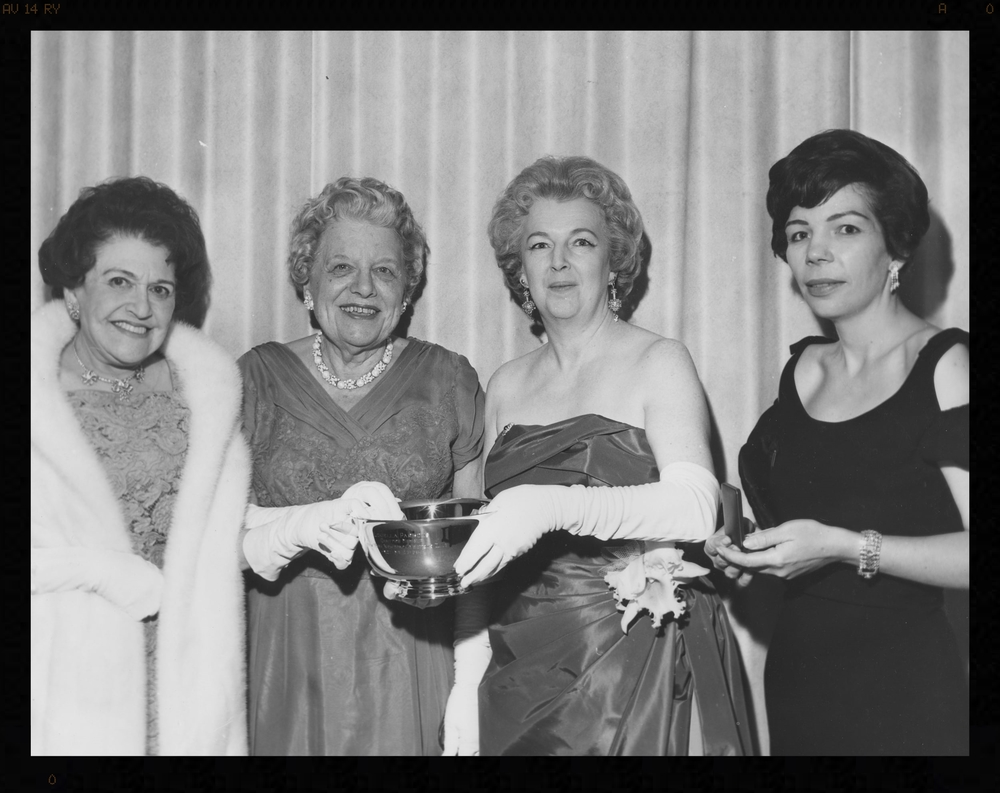 Louella Parsons, Emma Bugbee, Kay Lawrence and Christina Kirk at a ceremony honoring Bugbee's career at the New York Herald Tribune.  Bugbee's coverage of world events began with the sinking of the Titanic and continued through the 1960s. Lawrence was president of the Newswomen's Club in 1960 and 1961. Kirk was the club's president in 1963.