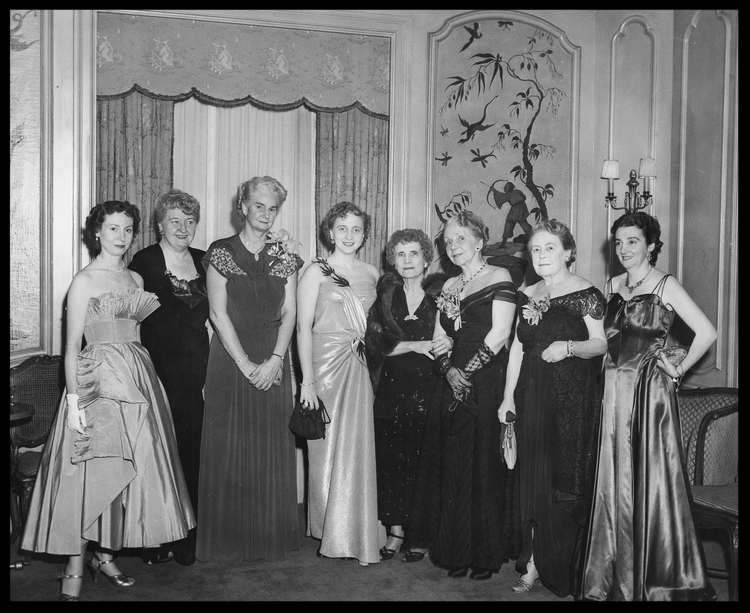 A host of legendary reporters formed the reception committee of an early New York Newspaper Women's Front Page Ball, attended by Margaret Truman (far left).