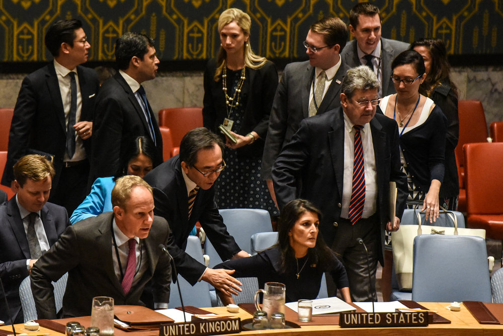 "BEST FRONT PAGE PHOTO:  Stephanie Keith and Sandy Ciric,  Getty Images "" Ambassador Nikki R. Haley called for more diplomacy with North Korea at a United Nations Security Council meeting on Monday"""