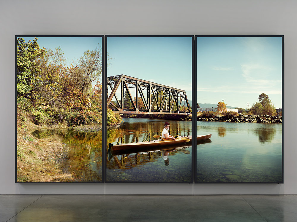 Rodney Graham,  Paddler at the Mouth of the Seymour  (2012-2013) three aluminum lightboxes with transmounted chromogenic transparencies Collection of the Vancouver Art Gallery.