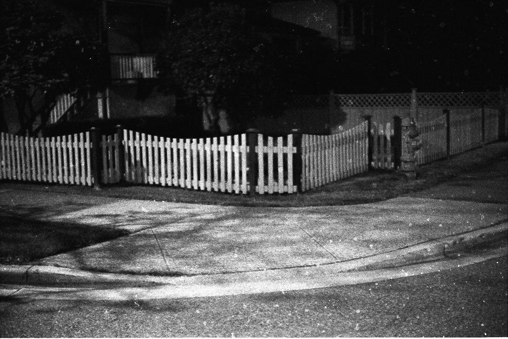 Joseph Strohan, Streetcorner Fence , 2017, silver gelatin print