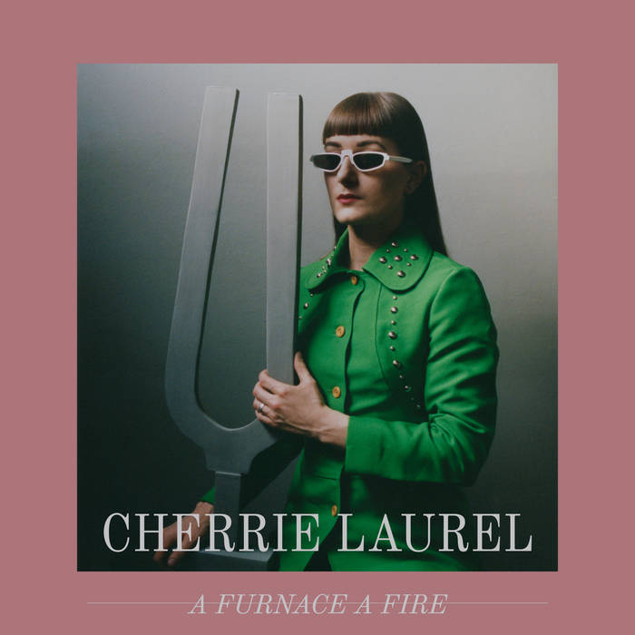 CHERRIE LAUREL TRACK: BREAKING THE SPELL ALBUM: A FURNACE, A FIRE