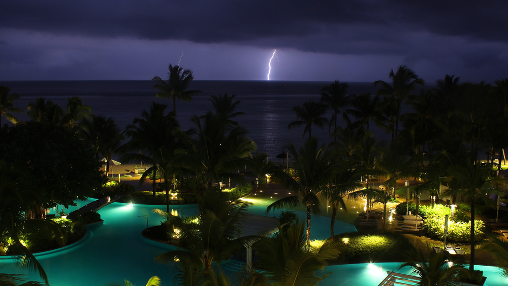Lighting strikes the ocean at Sugar Beach Resort & Spa