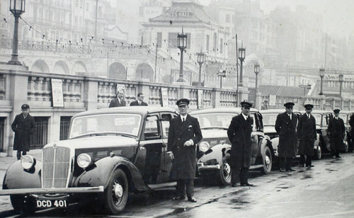 Streamline taxis at Madeira Drive in 1936, with some of its founding members.