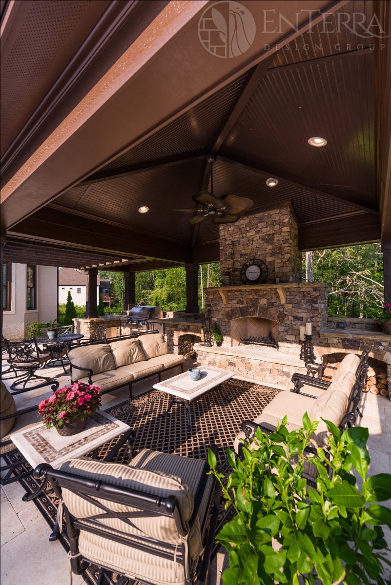 Pool cabana with fireplace, outdoor kitchen & pergola.