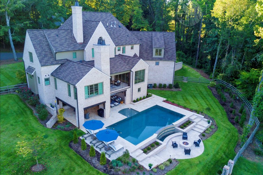 The project consist of a   20' x 40' main pool pool with a tanning ledge positioned towards the main covered living space on the rear of the home. The pool deck steps down to a lower fire pit patio with beautiful views of the vanishing edge spillway and the lower pond.