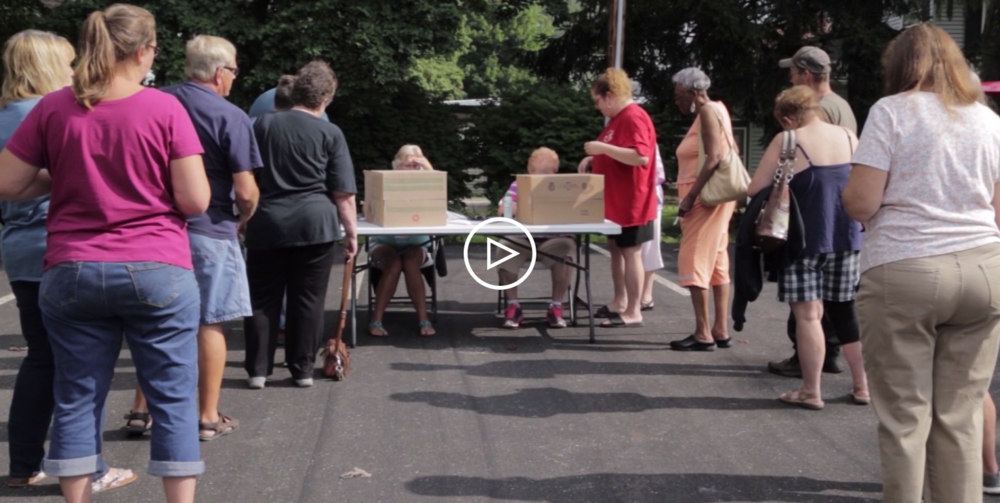 BNOC volunteers distribute thousands of pounds of produce, as featured in this IdeaStream news program.