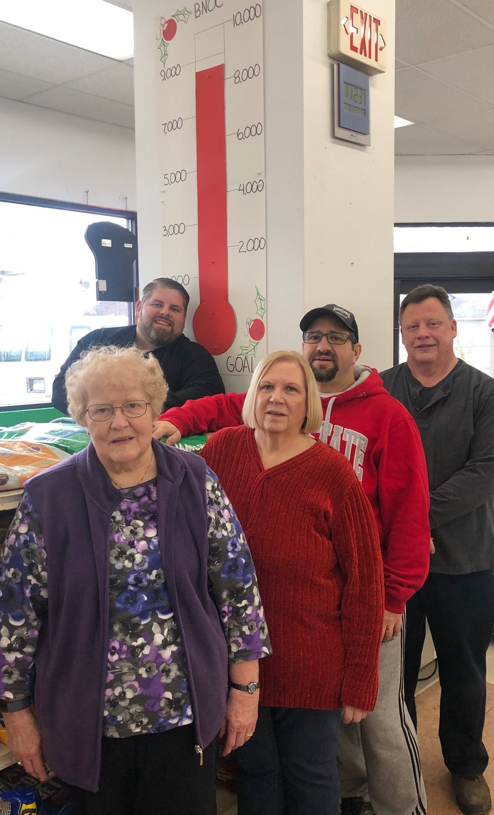 Pictured:  back left  - Jason Potes (owner of Stoodt's Market);  front row, left to right  - Carol Hoeflich (BNOC Food Pantry Manager), Charil Fuhrer (BNOC Clothesline Manager), Matt Merendino (BNOC President), and Dan Gradijan (a Stoodt's employee)