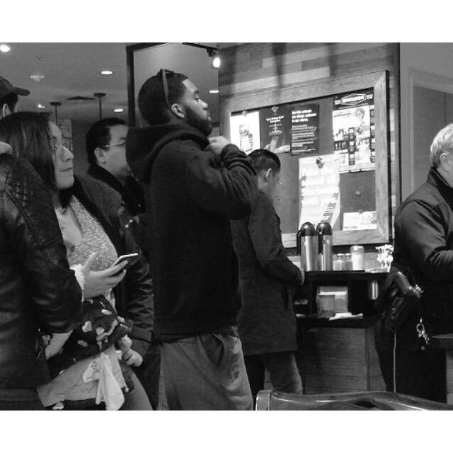 hoody wearing young man & police officer. I took this photo at a Starbucks in Dallas. 1/1