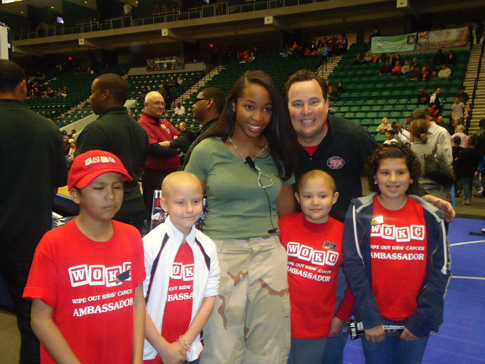 Green at Texas Legends Game with AMBASSADORS from Wipe Out Kids Cancer