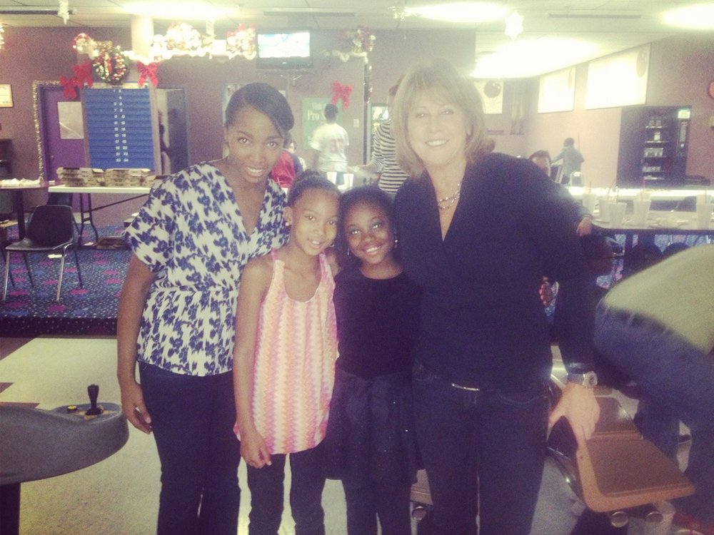 "WNBA LEGEND Nancy Lieberman & Green with their ""Littles"" at a Big Brother Big Sisters Bowling Event"